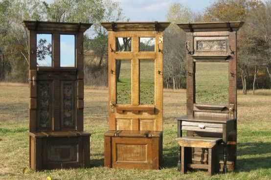 awesome old doors turned into entryway benches. Added mirrors, crown molding and hooks spruce them up