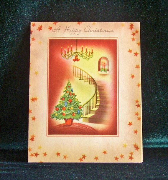 1940's Christmas card with art deco design inside. Beautiful tree, chandelier, and spiral stairway art. Printed by Copperfield.