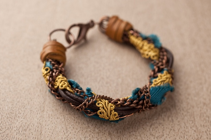 Fabric, leather and chains wrapped bracelet (Turquoise, mustard and brown). $29.00, via Etsy.