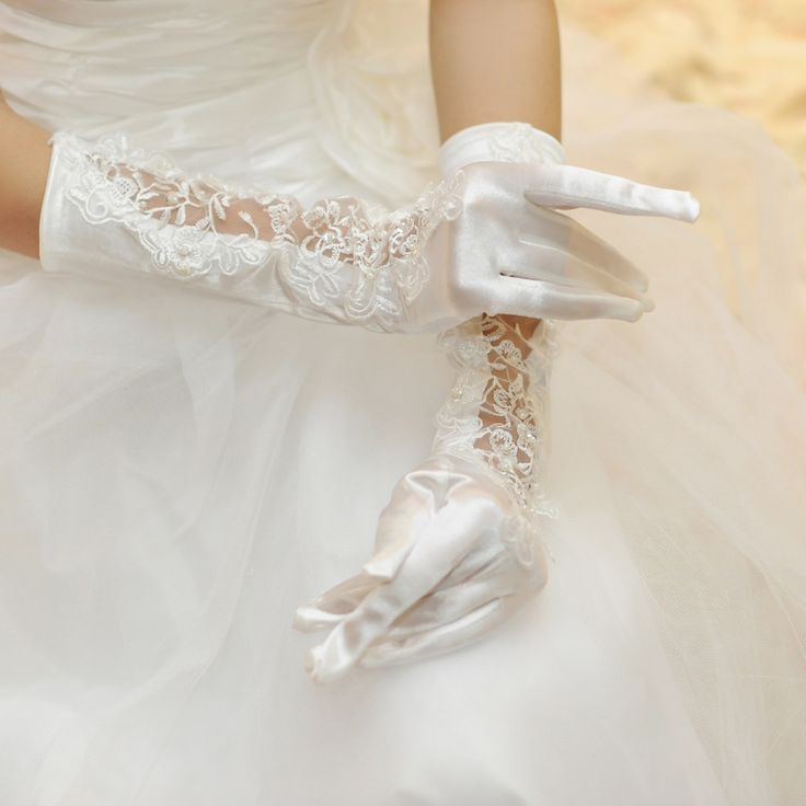 The white satin Pierced Bridal Gloves