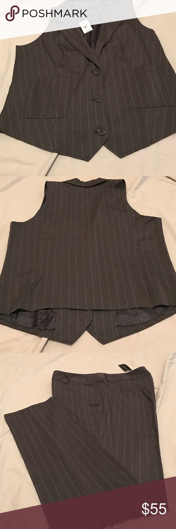 Suit Grey pinstriped suit, pants have front pockets. The vest has front pockets with 3 buttons down the front. Ashley Stewart Other