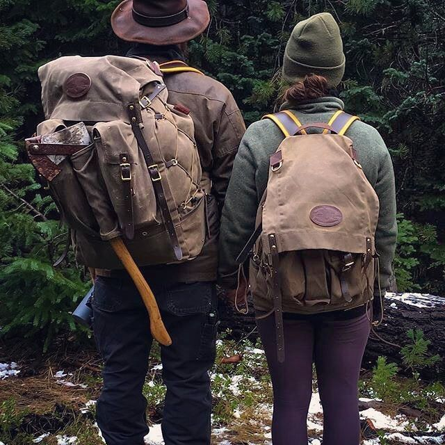 Our Isle Royale Bushcraft Pack and Isle Royale Jr. Bushcraft Pack, out in the wild with @bushcraft_camping_leatherwork & co. We hope that you get a chance to get outside this weekend, with you and yours. TGIF, enjoy! The Isle Royale Senior, Junior, and Mini are capable packs with double 2-in-1 pockets on the front on either side of an axe sleeve, featuring side cinch cordage and straps, and our buckskin padded backstraps, to name just a few of the features. They're made by hand in Duluth…