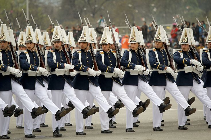 Officers and cadets of the Bernardo O'Higgins Military Academy marching through…
