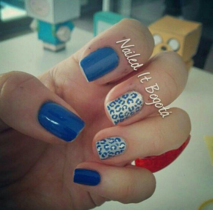 Blue animal print nail design