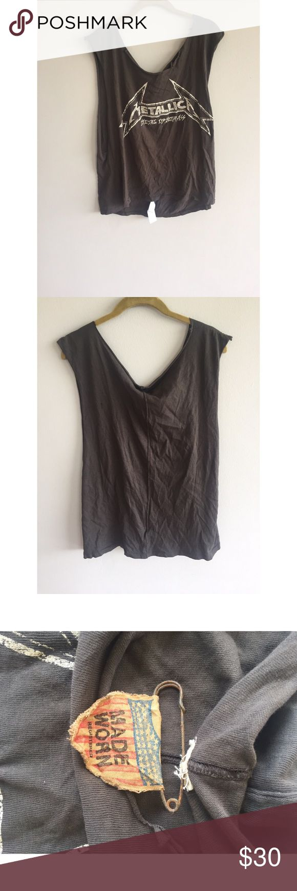 """METALLICA Gray Muscle Shirt This shirt is brand new. THE HOLES ARE SUPPOSED TO BE IN THE SHIRT. This muscle shirt measures approximately 100% Cotton Shirt measure approximately 21"""" Long METALLICA Tops Muscle Tees"""