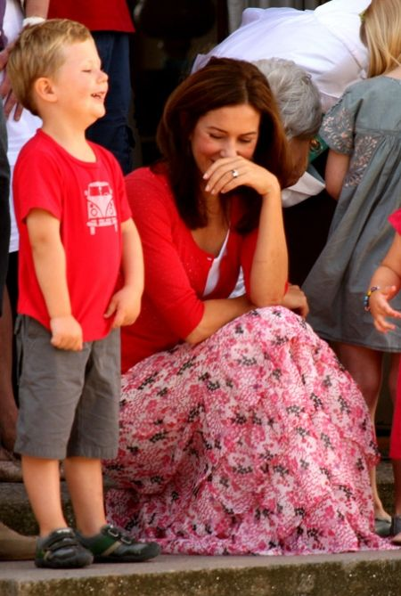 Prince Christian and Crown princess Mary of Denmark. What a precious natural shot!