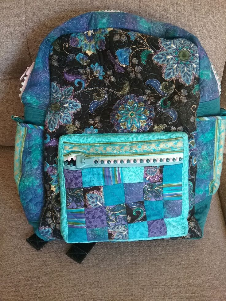 This is a backpack I made using the  ofher leftovers from Emily's quilt. Ready for my UK holiday!