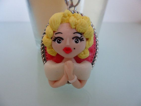 Check out this item in my Etsy shop https://www.etsy.com/pt/listing/294421511/marilyn-monroe-vintage-doll-necklace