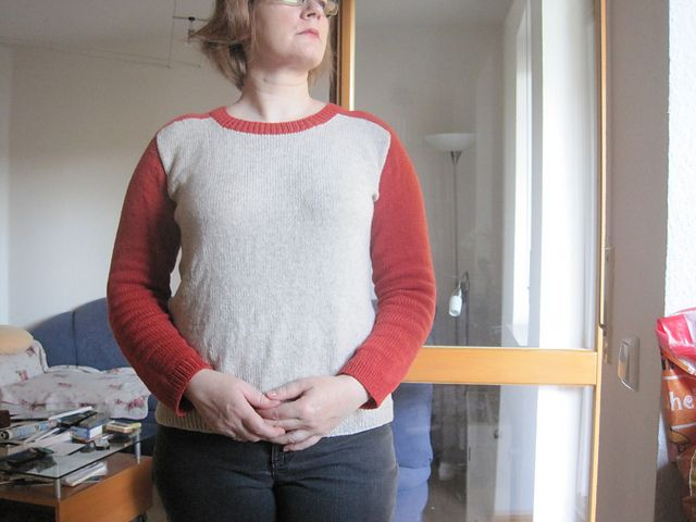 Ravelry: His or Her Sweater? pattern by Vera Sanon - super nice baseball tee style sweater, using the same technique for working a seamless saddle shoulder as is outlined in Barbara Walker's top down book (pg 86)
