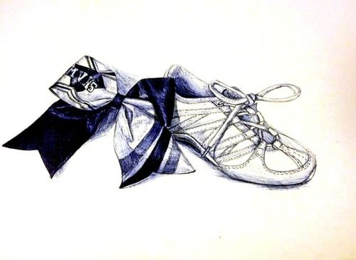 Cheer bow and shoe ballpoint pen still life