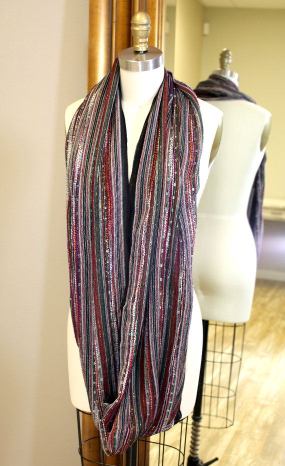 "FAST & FREE SHIPPING.  This shimmering infinity circle loop black multicolored scarf is a dazzling stunner, get showered by compliments! Pair it with a dress or jeans, go casual chic or formal stylish, this one is a work horse. Trendy infinity loop scarfs are all the rage at the moment, drape it anyway you want. Approx 35"" L X 27"" W inches loop, total length 70"" inches without loop. Soft Rayon blended with metallic gold threads. Colors may vary slightly in each scarf due to hand-dye proce..."