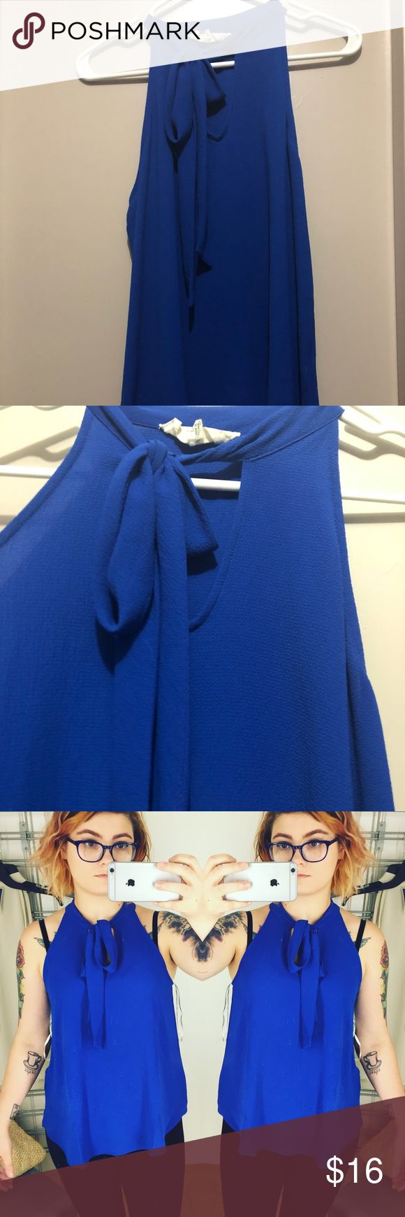 Royal Blue Tie Blouse. I bought this for staff pictures to cover a chest tattoo. And it worked! So I haven't worn it since. It's a linen material, very breathe-able. In a true royal blue. Modcloth Tops Blouses
