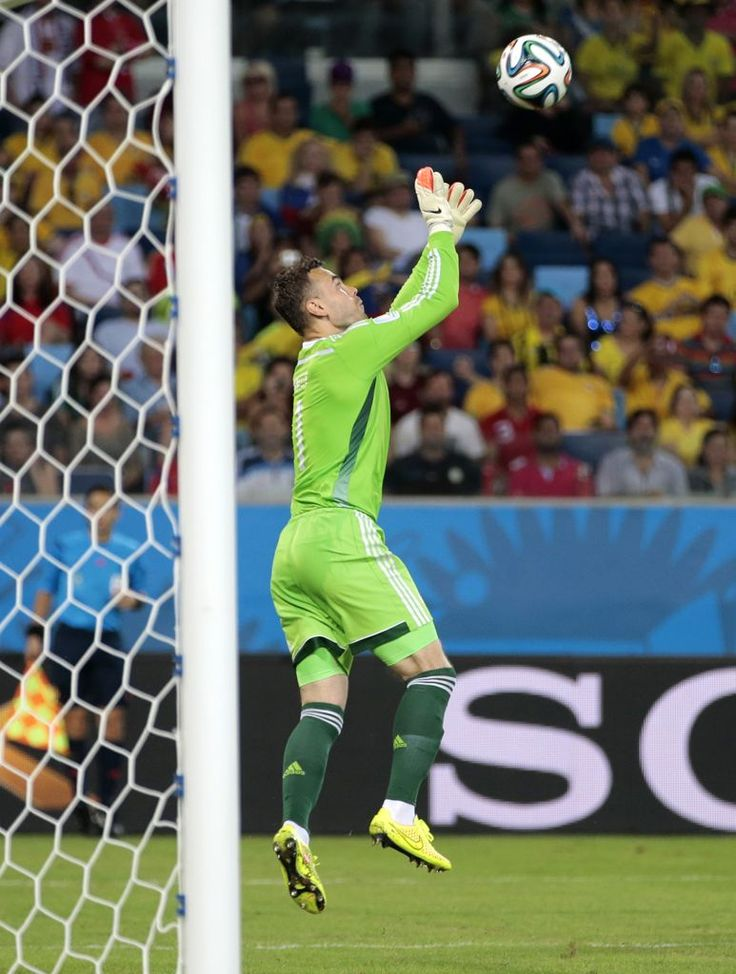 Russia's goalkeeper Igor Akinfeev catches the ball in front of the goal