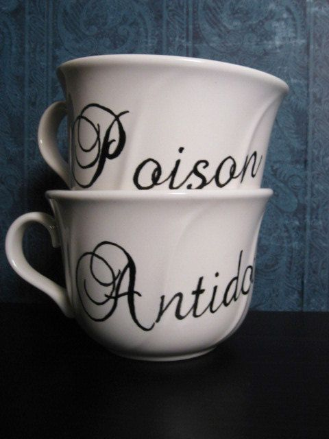 Poison/Antidote Tea Cup Set. (read: COFFEE cup. i don't like tea unless it's full of ice and sugar.)