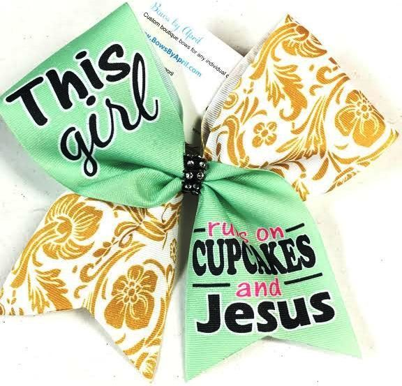 Bows by April - This Girl Runs on Cupcakes and Jesus Sublimated Cheer Bow, $15.00 (http://www.bowsbyapril.com/this-girl-runs-on-cupcakes-and-jesus-sublimated-cheer-bow/)