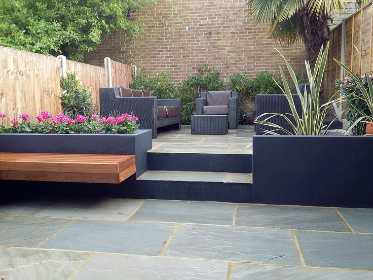 sandstone paving patio hardwood floating bench dark grey rendered walls london low maintenance garden dulwich west norwood clapham