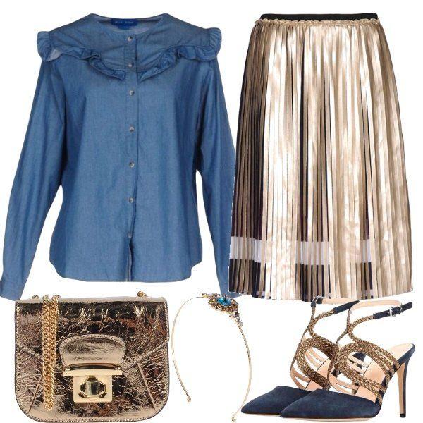 Per un party modaiolo, osiamo la camicia di jeans con il volant, abbinata ad una gonna plissettata dorata, scarpe blu con motivi dorati, piccola tracolla preziosa e cerchietto gioiello.