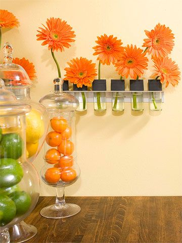Just my favorite colors in the kitchen.. oranges, yellows, lime greens.. they are just missing the blue/green as an accent.. but this so pretty love the jars with the fruit in them!