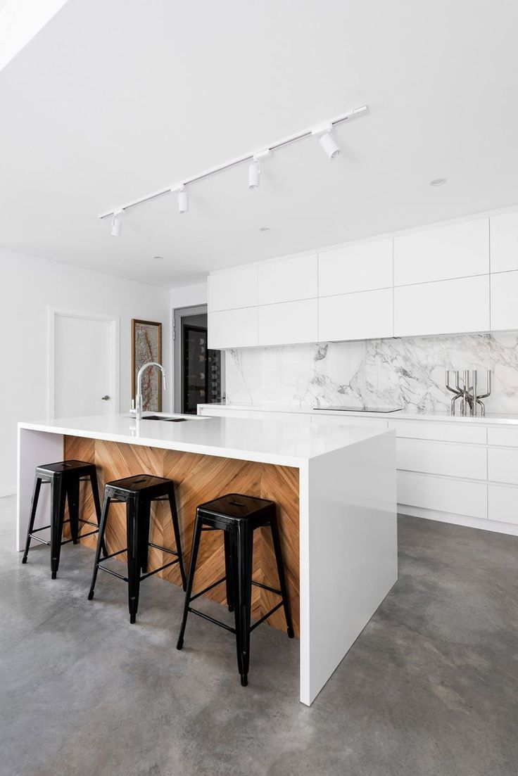 White Modern Kitchen With Marble Slab Backsplash Wood And Pure White Island And Concrete Floors Kitchen Design Open Modern Kitchen Design Modern Kitchen