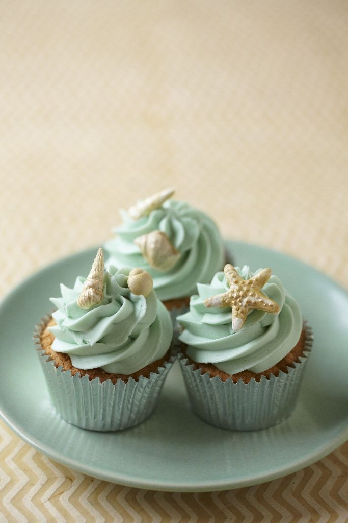 Cute beach theme cupcakes... now how would I go about making the starfish/seashell for the top?