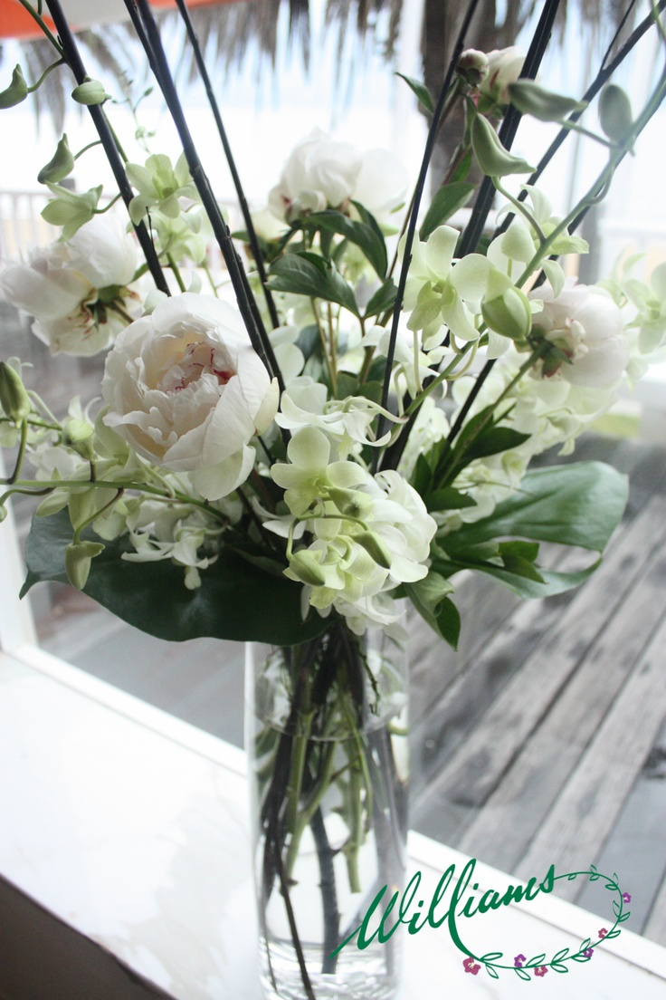 White Peony Roses, Singapore Orchids, Sticks and Tropical Leaves.