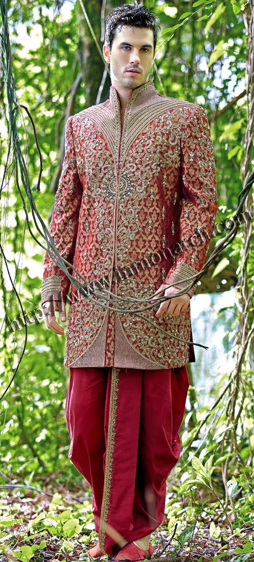 Golden embroidered work designer wedding sherwani made from maroon color brocade fabric. Hand embroidered as shown. It has bottom as dhoti made from dupion fabric in maroon color.