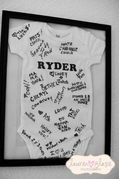 baby shower onesie guestbook- everyone can sign a onesie with the baby's name on it instead of signing a guestbook.  Then the onesie can be framed and hung in the baby's room.   click on the pic for more baby shower ideas...