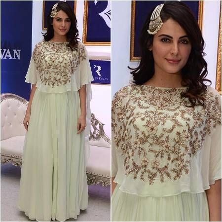 Mandana Karimi – Yay or Nay?.. The reality star has a lot of great styles and looks to her credit – we don't get why she'd do this to herself! In a pale green skirt and top combo, Karimi looked like a drab Arabian Nights character! We do love the embroidery on the Kalki cape!... Get the look at https://www.estrolo.com/whatstrending/mandana-karimi-yay-or-nay/