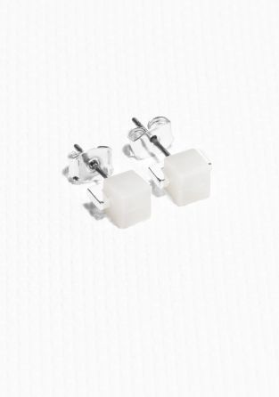 & OTHER STORIES Modern minimalism is featured in these sleek stud earrings with a cube shape.