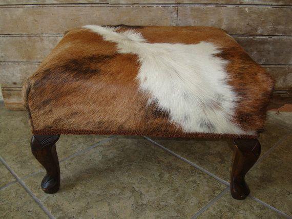 Cowhide ottoman, $85