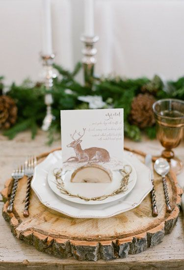 Using wood slabs as both a placemat and place card holder are an easy way to make a Thanksgiving table feel like a woodland gathering.