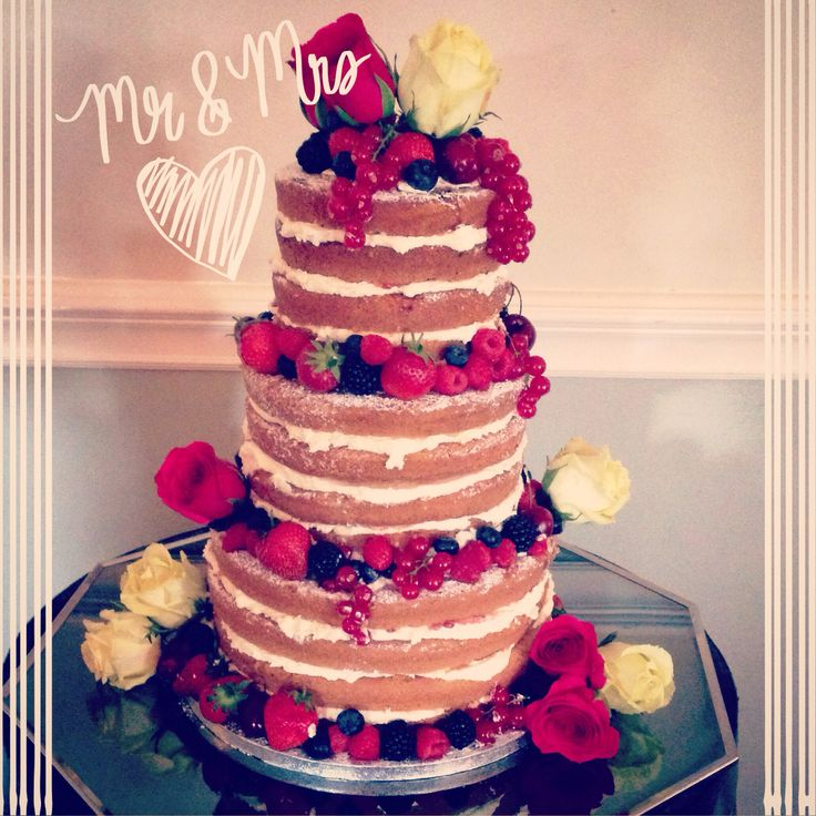 'Naked' cake: filled and decorated with fresh berries and roses. www.kellylou.com