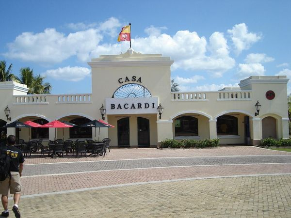 The entrance to Casa Bacardi with tables and chairs out front.