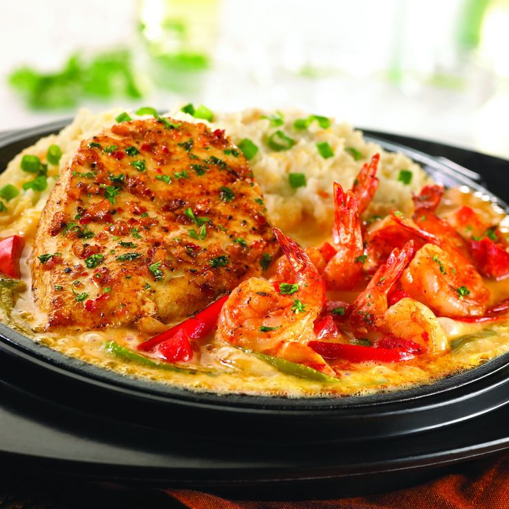 Friday's: Sizzling Chicken & Shrimp - Sauteed garlic-marinated chicken breast and plump shrimp tossed with zesty bruschetta marinara. Served with onions & peppers and our creamy mashed potatoes on sizzling platter of melted Mexican and American cheeses.