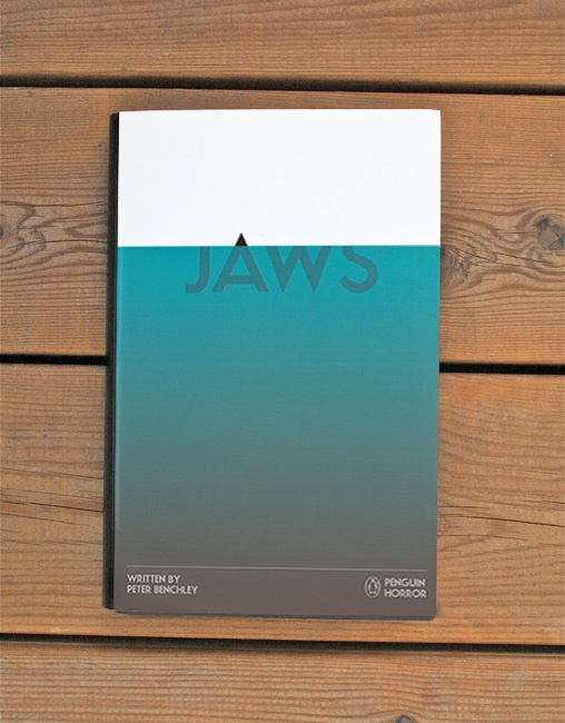 'Jaws' from the Penguin Horror book series by Tom Lenartowicz  I'm a big fan of minimal design for book covers. Most of the letters being underwater like a shark and the top of the 'A' being out like a fin is very clever and effective.