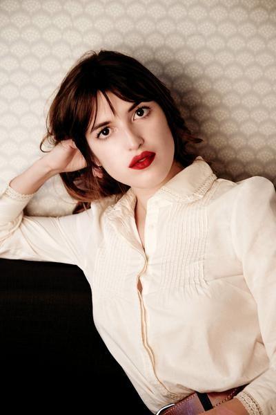 Jeanne Damas in a pintuck cotton blouse, leather belt, gorgeous lip color.