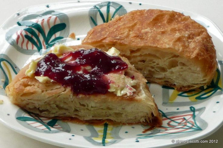 Buttery Rowies - Rowies are a flaky, croissant like roll, quite salty, made with a mixture of lard and butter .  They're usually served toasted and spread with jam and butter.