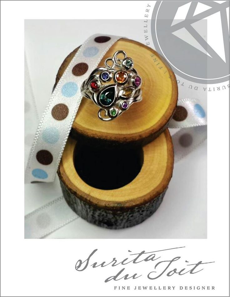 9K white gold engagement ring set with various natural gemstones. Manufactured by Surita du Toit.