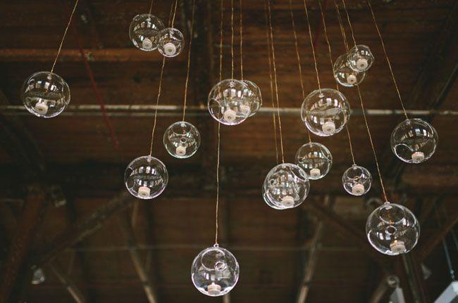 glass tea light holders hung at varying lengths