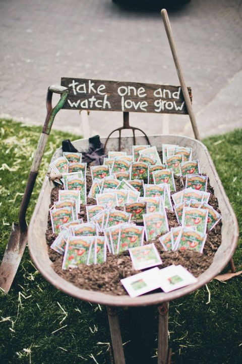 A wheelbarrow full of soil and seed packets is a fitting favor display for an intimate wedding at an apple orchard. Prop up a handmade sign on a rake head and rest a couple other farm implements alongside for an extra rustic vibe.