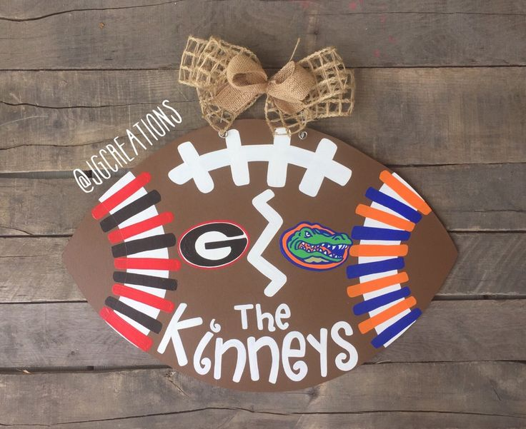 HOUSE DIVIDED Football Door Hanger, Wooden Sign, Hand Painted, Fall Decor by jgcreationsbyjg on Etsy https://www.etsy.com/listing/246579588/house-divided-football-door-hanger
