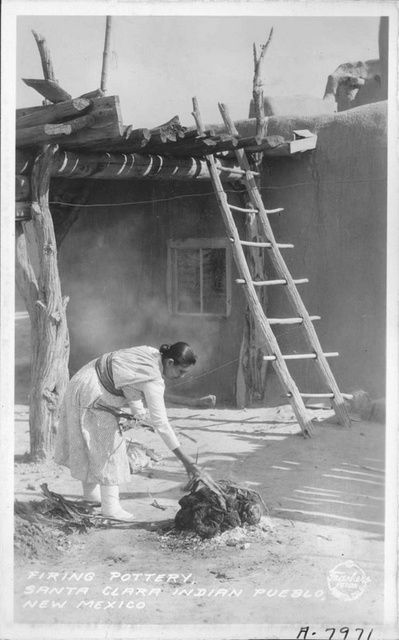 Firing Pottery, Santa Clara Indian Pueblo, New Mexico  Date:1934  Contributing Institution:  Pomona Public Library