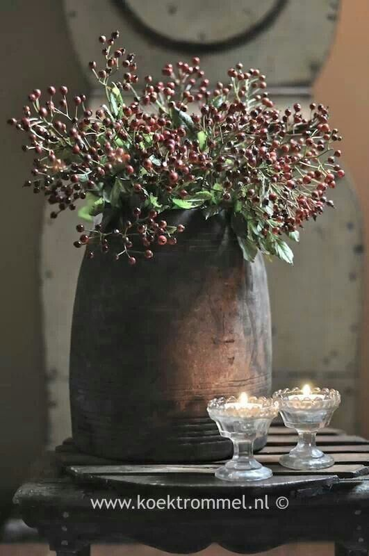 autumn berries in a beautiful old pot