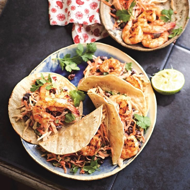 "PRAWN TACOS WITH BLACK BEAN AND CABBAGE SALAD BY CHRISSY FREER. ""Tacos can be healthy! Spicy marinated prawns and a crisp cabbage and bean salad with a creamy, tangy yoghurt-based dressing make these tacos light and fresh"" says Chrissy. 30 Minutes."