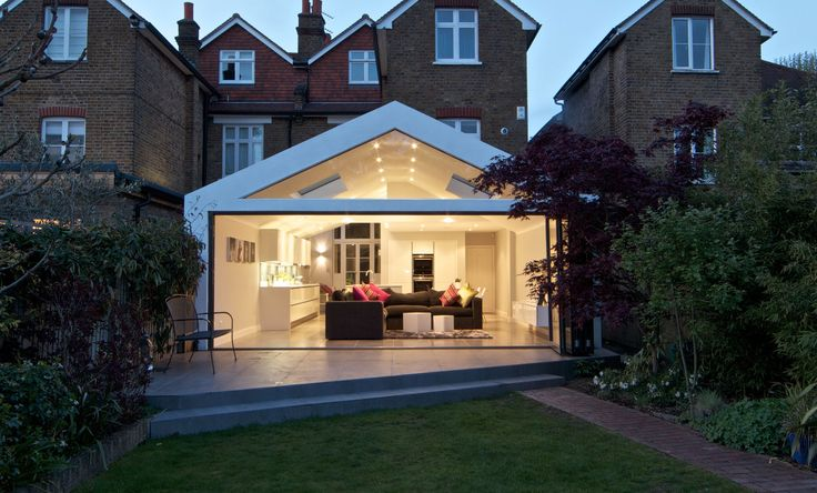A gable roof extension with a modern twist as the contemporary gable follows the existing contours of the traditional roofs above.