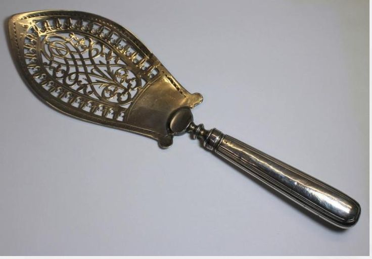 Hester Bateman.  fish server with openwork blade - London city stamps,  date letter of 1788. Asking $775. Open to offers