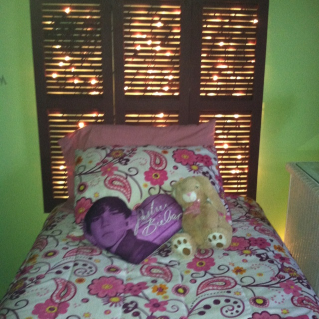 Teen's headboard made with used shutters and Christmas lights.