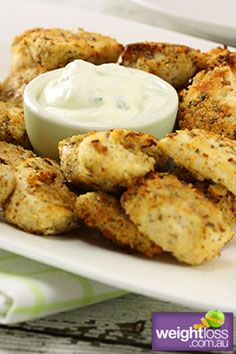 Healthy Snack Recipes: Parmesan Crusted Chicken Nuggets with Tzatziki Dip. #HealthyRecipes #DietRecipes #WeightLoss #WeightlossRecipes weightloss.com.au