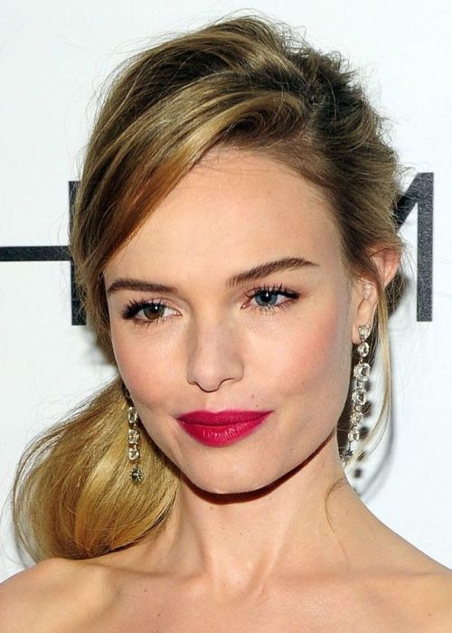 30 Best Hairstyles for Big Foreheads | herinterest.com - Part 3American actress, model and singer Kate Bosworth looks fabulous with her sexy low ponytail and a flattering side fringe. The low ponytail is a grown-up and sexy version of the regular ponytail, and it's perfect for women with big foreheads as it draws attention away from the hairline. The side fringe is a bonus, as it partially covers a big forehead.