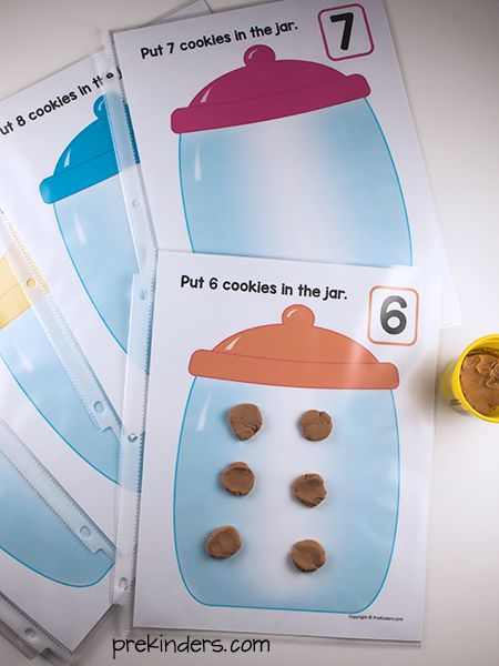 These free printable Cookie Jar Play Dough Mats combine fine motor and math skills in a fun way. Just print and add play dough or cookie cereal.